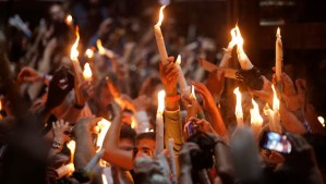 Christian pilgrims hold candles at the church of the Holy Sepulcher, traditionally believed to be the burial site of Jesus Christ, during the ceremony of the Holy Fire in Jerusalem's Old City on Saturday, April 19, 2014. (AP Photo/Dan Balilty)