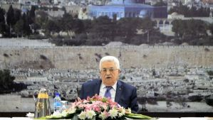 Palestinian president Mahmud Abbas chairs a meeting of the Executive Committee of the Palestine Liberation Organization (PLO) to discuss the fate of 26 veteran Palestinian prisoners who Israel was to have freed this weekend under terms of an agreement which brought about a resumption of talks on March 31, 2014 in the West Bank city of Ramallah. The Palestinians say they will not even consider extending the talks without the prisoners being freed, but Israel has refused to release them without a Palestinian commitment to continue the talks, prompting a fresh crisis of confidence. AFP PHOTO / ABBAS MOMANI