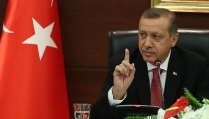 Turkish Prime Minister Recep Tayyip Erdogan speaks to the media in his office in Ankara on April 23, 2014. (AP Photo)