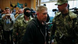 The self-styled mayor of Slaviansk, Vyacheslav Ponomaryov, leaves a news conference in the mayor's office in Slaviansk on April 26, 2014. Separatists in the eastern Ukrainian city of Slaviansk are ready to exchange a group of international observers they are holding for fellow rebels who are in the custody of the Ukrainian authorities, Ponomaryov said on Saturday. (REUTERS/Gleb Garanich)