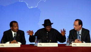 Nigerian president Goodluck Jonathan (C), answers reporter's questions as Cameroon President Paul Biya (L), and French President François Hollande (R) look on during the press conference ending the Paris Summit for Security in Nigeria at the Elysée Palace in Paris on Saturday, May 17, 2014. (AP Photo/François Mori)