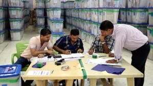 Iraqi electoral workers count ballots at a counting center in Baghdad, Iraq, on Wednesday, May 14, 2014. (AP Photo/ Karim Kadim)