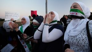 Syrian expatriates chant anti-Assad slogans as they celebrate the Jordanian government's decision to expel the Syrian ambassador, Bahjat Suleiman, in Amman, Jordan, on May 26, 2014. (AP Photo/Mohammad Hannon)