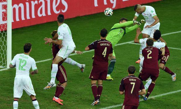 Germany, US and Algeria advance, Suarez banned