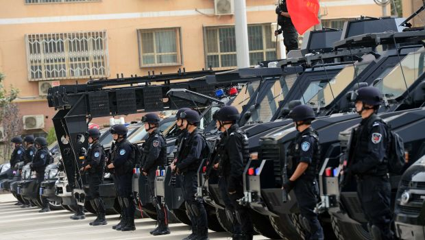 Chinese police shoot dead 13 attackers in restive Xinjiang