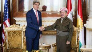 Kurdish President Massoud Barzani (R) shakes hands with US Secretary of State John Kerry at the presidential palace in Erbil, Iraqi Kurdistan, on June 24, 2014. (AP Photo/ Brendan Smialowski, Pool)