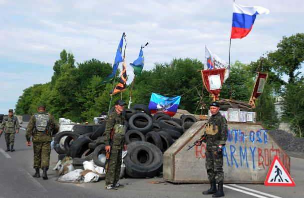 Ukraine threatens to retake territory from defiant rebels