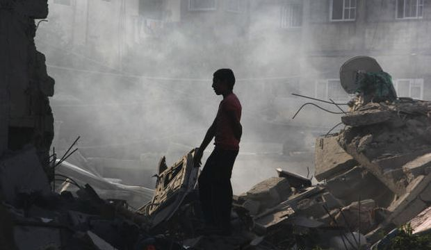 Ten dead in strike on Gaza school as Israel renews shelling