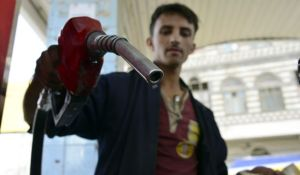 A Yemeni attendant holds a fuel nozzle at a gas station following rises in fuel prices in Sana'a, Yemen, on July 30, 2014.(EPA/YAHYA ARHAB)