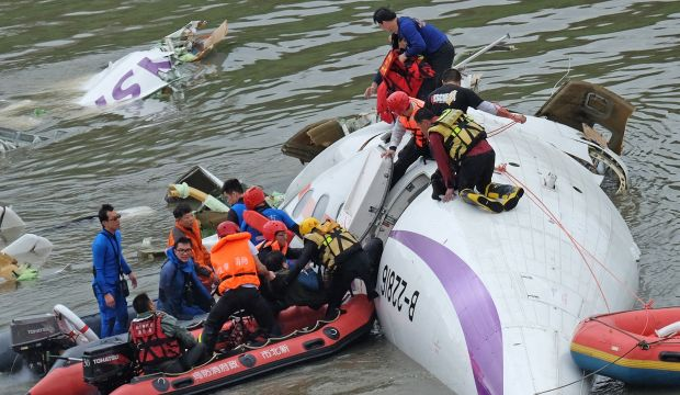 Taiwan plane cartwheels into river after take-off, killing at least 16
