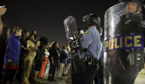 Police and protesters square off outside the Ferguson Police Department, Wednesday, March 11, 2015,