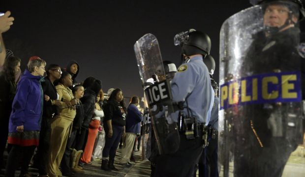 Two officers shot outside Ferguson police HQ after chief quits
