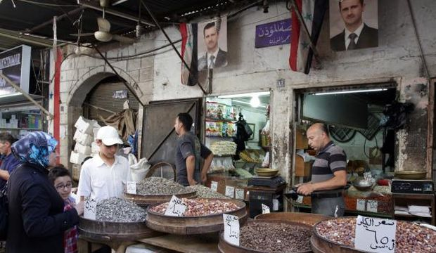 """Syrian economy """"devastated"""" by conflict: report"""