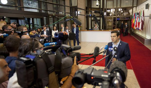 Euro zone strikes deal with Greece after all-night struggle
