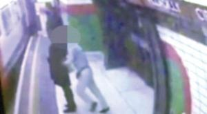 Picture of woman being pushed into train