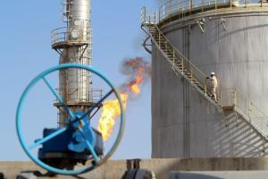 A worker climbs stairs at the Halfaya oilfield in Amara, southeast of Baghdad