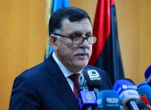 Fayez Serraj speaks at a press conference in Tripoli.
