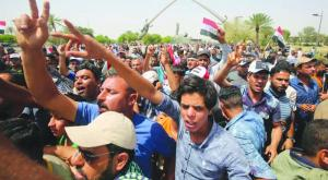 Iraqis protest before the Parliament in the Green Zone in Baghdad