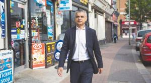 Sadiq Khan heading toward the City Hall in his first day for being London's Mayor on Monday.jpg