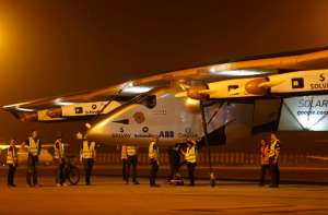 """Ground staff prepare to push the """"Solar Impulse 2"""", a solar powered plane, into a hangar after it landed at the airport in the western Indian city of Ahmedabad March 11, 2015. REUTERS"""