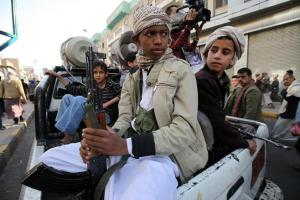 Child soldiers with Houthis hold weapons in Sana'a, Yemen. Reuters.