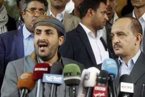 Mohammed Abdul-Salam (L), head of the Houthi delegation to scheduled peace talks in Kuwait, speaks at a news conference at Sanaa Airport, Yemen, April 20, 2016.