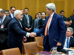 Foreign Minister of Iran, Mohammad Javad Zarif shakes hands with US Secretary of State John Kerry at the last working session of nuclear negotiations on July 14, 2015 in Vienna, Austria.