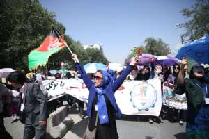 Thousands of demonstrators march towards the center of Kabul, Afghanistan, Saturday, July 23, 2016.