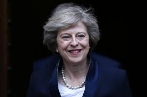 Theresa May emerges to speak to reporters after being confirmed as the leader of the Conservative Party and Britain's next Prime Minister outside the Houses of Parliament in Westminster, central London, July 11, 2016. REUTERS/Neil Hall