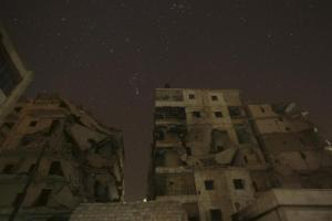 Damaged buildings are pictured at night in Aleppo, Syria December 11, 2015. REUTERS/Ammar Abdullah