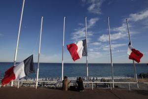 Flags fly at half-mast in memory of victims the day after a truck ran into a crowd at high speed killing scores and injuring more who were celebrating the Bastille Day national holiday, in Nice. REUTERS/Eric Gaillard