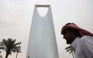 Man walks past the Kingdom Centre Tower in Riyadh