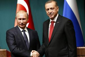Russia's President Vladimir Putin, left, shakes hands with Turkey's President Tayyip Erdoğan after a news conference at the Presidential Palace in Ankara, Turkey, on December 1, 2014. Reuters