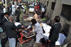 People comfort each other following a bomb blast in Quetta, Pakistan, Monday, Aug. 8, 2016. Arshad Butt, AP