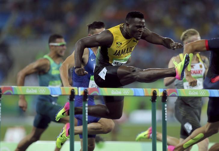 Olympics-Athletics-Clement Wins 400m Hurdles, Culson Left Sobbing