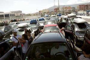 People wait with their cars to get on a ferry to Morocco at the southern Spanish port of Algeciras July 31, 2015. REUTERS/Jon Nazca