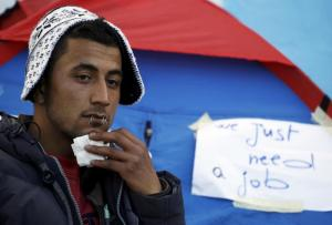 Yosri Adjili, 25, who is unemployed, goes on a hunger strike with his mouth sewed shut during a sit-in protest to get jobs, at the local government office courtyard in Kasserine, Tunisia, January 27, 2016. On December 17, 2010, a young, desperate Tunisian vendor named Mohamed Bouazizi set himself ablaze in a suicide protest over unemployment and police abuse that spread revolt across the Arab world. Five years on, Ridha Yahyaoui, another young Tunisian, has killed himself in frustration after being refused a job, inflaming protests through the same impoverished towns that once brought down the regime of Zine El-Abidine Ben Ali. REUTERS/Zohra Bensemra