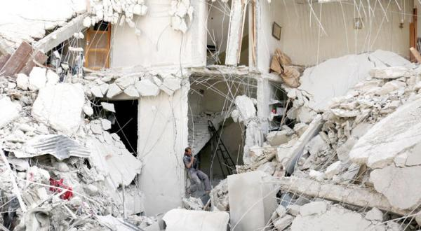 Residential Buildings Are Razed to the Ground in Raids on Aleppo