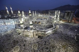 Muslim pilgrims circle the Kaaba as they pray inside and outside the grand Mosque in Makkah