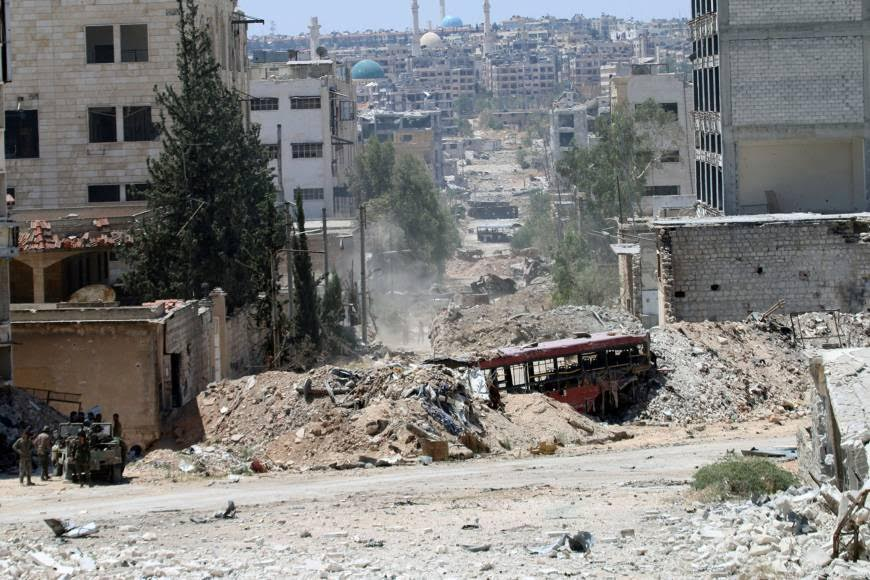 Syria's Ceasefire: Cautious Calm as Tanks Fire Shells on Aleppo Countryside