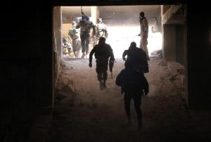 Rebel fighters from the Jaish al-Fatah (or Army of Conquest) brigades gather in position at an entrance to Aleppo, in the southwestern frontline near the neighbourhood of Dahiyet al-Assad, on November 3, 2016