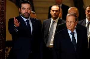 Christian politician Michel Aoun, right, with Lebanon's former prime minister, Saad Hariri, left.