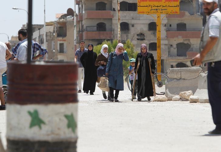 Phenomenon Spreads in Damascus: Citizens in Military Costumes