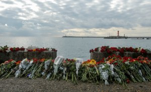 Flowers in memory of passengers and crew members of Russian military Tu-154, which crashed into the Black Sea on its way to Syria on Sunday, are placed at an embankment in the Black Sea resort city of Sochi, Russia, December 26, 2016.