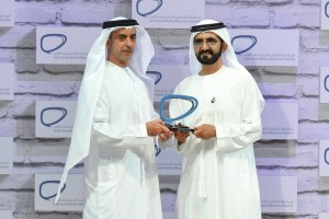 Sheikh Mohammed bin Rashid, Vice President and Ruler of Dubai, presents Sheikh Saif bin Zayed, Minister of Interior and Deputy Prime Minister, with the award for the category of individuals representing the public sector in the second Arab Social Media Influencers Summit.