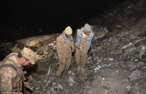 Pakistani soldiers search for victims from the wreckage of the crashed PIA passenger plane Flight PK661 (AFP)