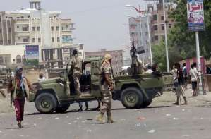 People gather at the scene following an attack by a suicide bomber who drove a car laden with explosives into a compound run by local militias in the port city of Aden, Yemen on Aug. 29, 2016. REUTERS