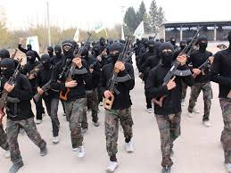 Islamist fighters carry weapons as they march during their graduation ceremony at a camp in eastern al-Ghouta, near Damascus November 28, 2013. The newly graduated fighters, who went through military training, will operate under the Islamist Ahrar al-Sham brigade.