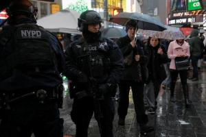 Members of the NYPD's Counterterrorism Bureau patrol Times Square in the lead up to New Year's celebrations in Manhattan