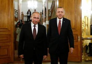 Russian President Putin and his Turkish counterpart Erdogan arrive for a joint news conference following their meeting in Istanbul